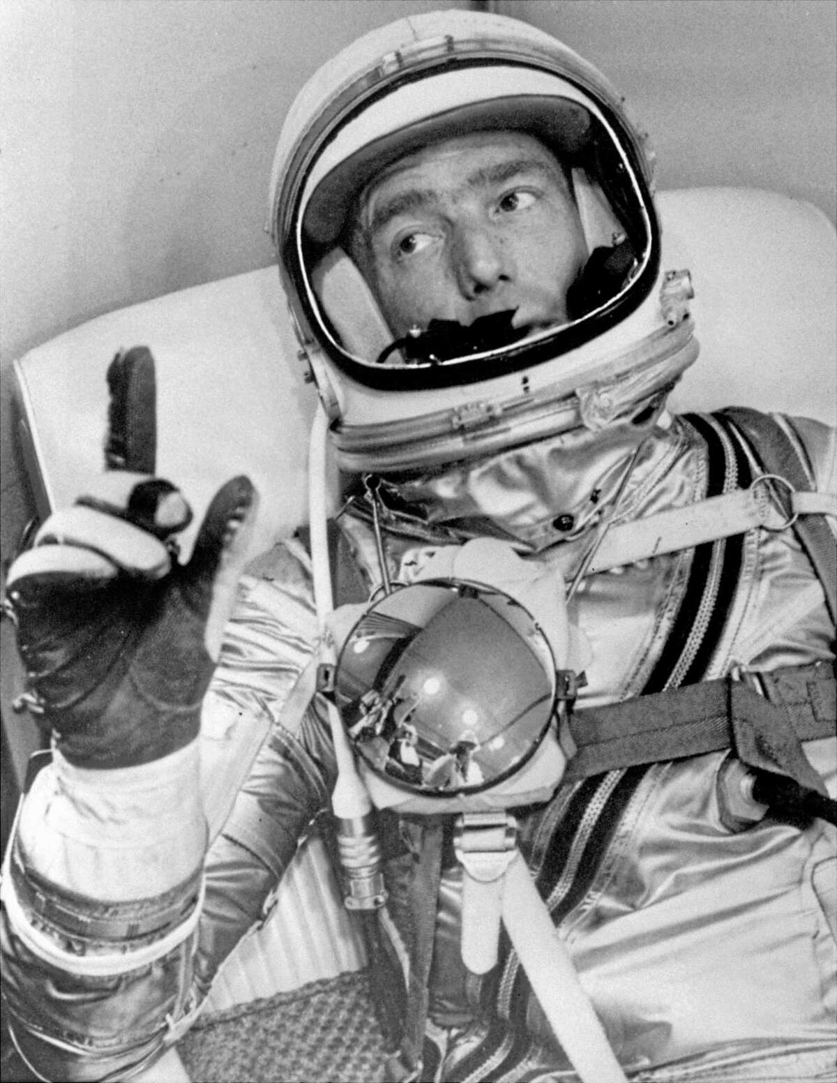 FILE - In this May 24, 1962 file photo provided by NASA, astronaut Scott Carpenter gestures with one hand after donning his space suit in Hangar S prior to being shot into orbit at Cape Canaveral, Fla. Carpenter, the second American to orbit the Earth and first person to explore both the heights of space and depths of the ocean, died Thursday, Oct. 10, 2013 after a stroke. He was 88. (AP photo/NASA, File)