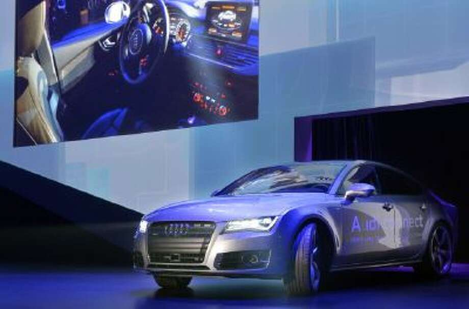 Audi's autonomous car drives on stage during the Audi keynote at the International Consumer Electronics Show, Monday, Jan. 6, 2014, in Las Vegas.