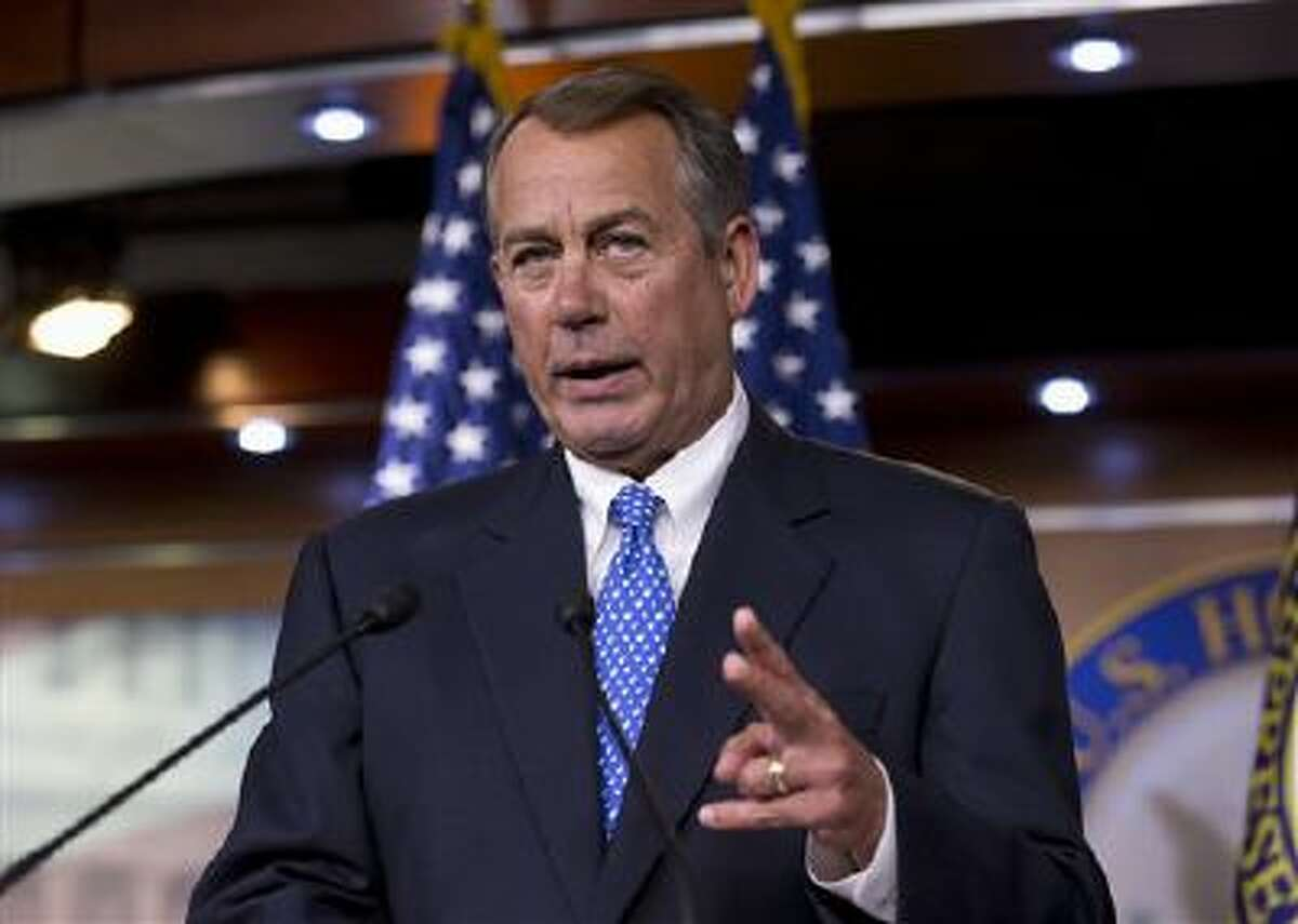 House Speaker John Boehner of Ohio takes reporters' questions on NSA leaker Edward Snowden, the economy, and the unfinished work of the House in passing a spending bill, as Congress prepares to leave for a five-week recess, Thursday, Aug. 1, 2013 during a news conference on Capitol Hill in Washington. (AP Photo/J. Scott Applewhite)