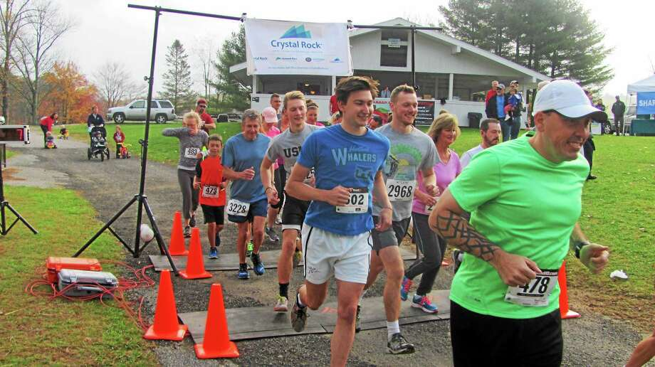 Fifty runners of all ages took part in the Warren Park and Recreation Cider Run 5K Saturday morning at Warren Woods. Photo: John Nestor — Special To The Register Citizen