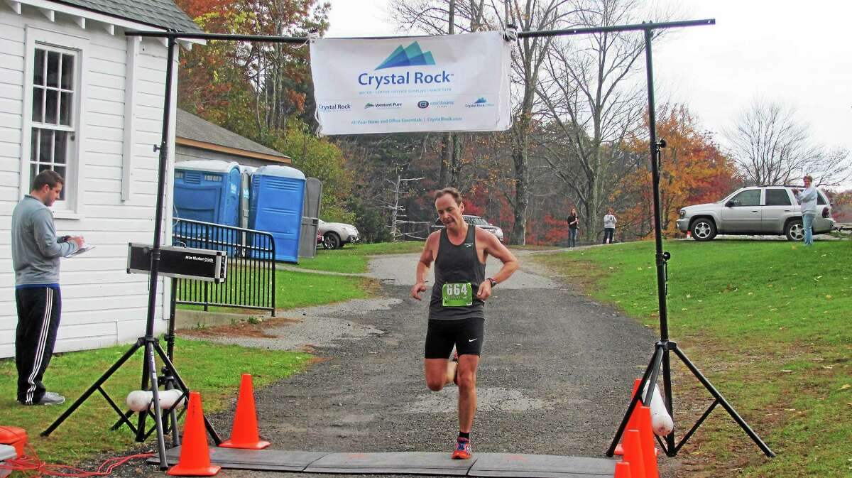 Justin Burchett, 41, of New York won the Warren Park and Recreation Cider Run 5K Saturday with a time of 18:54.