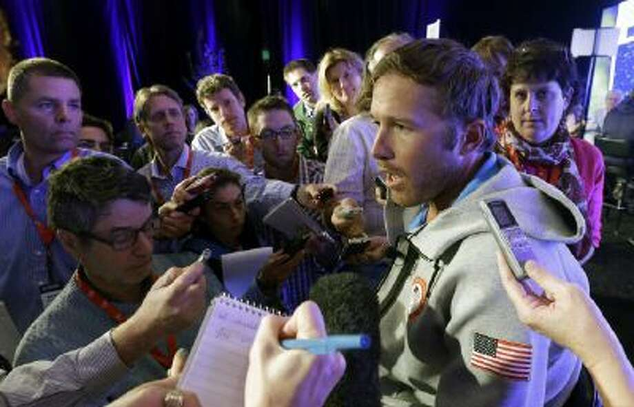 Olympic and World Championship gold medalist skier Bode Miller speaks with reporters during a news conference at the USOC 2013 team USA media summit Monday, Sept. 30, 2013, in Park City, Utah.