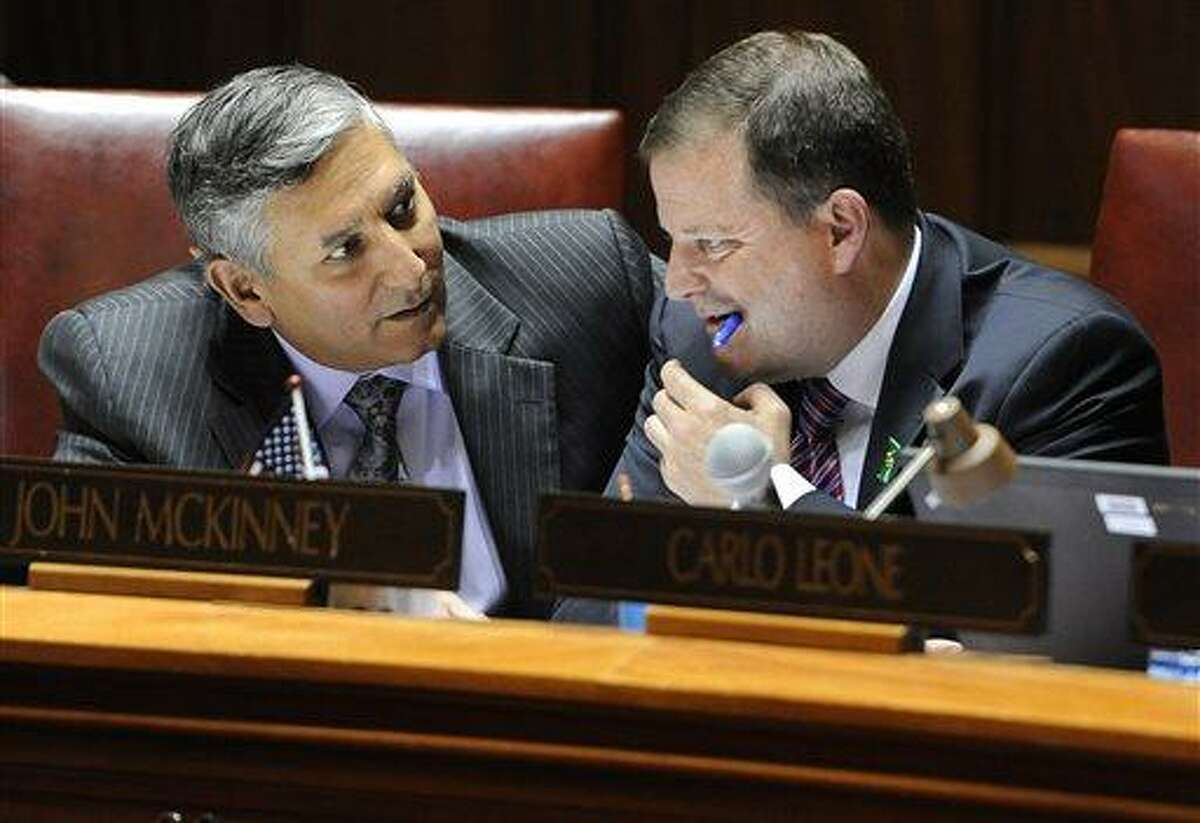 State Sen. Len Fasano, R-North Haven, left, speaks with Senate Minority Leader John McKinnery, R-Fairfield, during the final day of session at the Capitol in Hartford, Conn., Wednesday, June 5, 2013. Lawmakers wrap up a session that was dominated at the beginning and the end by issues related to the shooting at Sandy Hook Elementary School. (AP Photo/Jessica Hill)