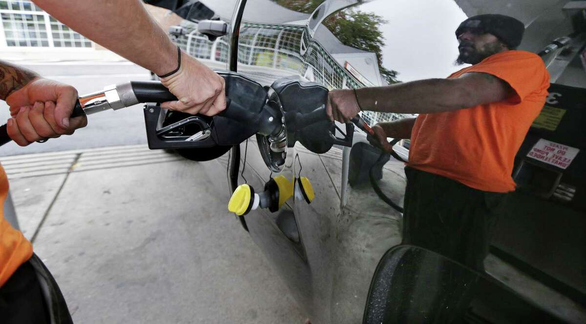 In this Sept. 30 photo, Dana Ripley, of Winthrop, Massachusetts, fills the gas tank of his truck at a service station in Andover.