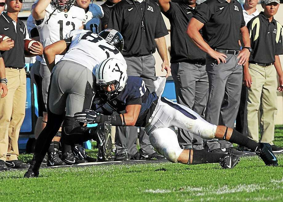 Yale sophomore Spencer Rymiszewski makes a tackle during the Bulldogs' win over Army last month. Photo: Photo Courtesy Of Yale Athletics  / 2014 All Rights Reserved
