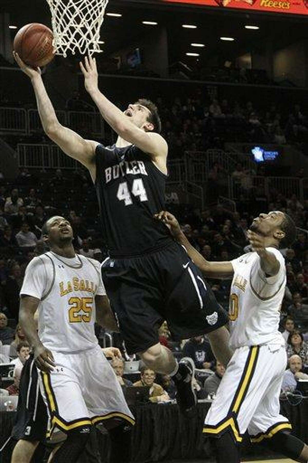 Butller's Andrew Smith (44) goes up past La Salle's Jerrell Wright (25) and Sam Mills during the second half of an NCAA college basketball game at the Atlantic 10 Conference tournament, Friday, March 15, 2013, in New York. Butler won 69-58. (AP Photo/Mary Altaffer)