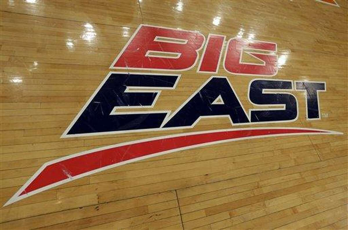 A Big East logo is displayed on the court at Madison Square Garden before an NCAA college basketball game between Marquette and St. John's Saturday, March 9, 2013,in New York. The conference has reached an agreement with seven departing basketball members that will allow them to separate from the football schools and create their own conference on July 1. Commissioner Mike Aresco told The Associated Press on Friday the seven Catholic schools that are leaving to form a basketball-centric conference will get the Big East name, along with the opportunity to play their league tournament in Madison Square Garden.(AP Photo/Richard Drew)