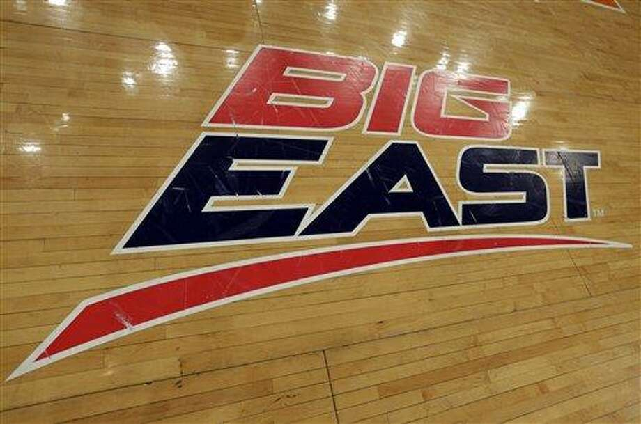 A Big East logo is displayed on the court at Madison Square Garden before an NCAA college basketball game between Marquette and St. John's Saturday, March 9, 2013,in New York. The conference has reached an agreement with seven departing basketball members that will allow them to separate from the football schools and create their own conference on July 1. Commissioner Mike Aresco told The Associated Press on Friday the seven Catholic schools that are leaving to form a basketball-centric conference will get the Big East name, along with the opportunity to play their league tournament in Madison Square Garden.(AP Photo/Richard Drew) Photo: ASSOCIATED PRESS / AP2013