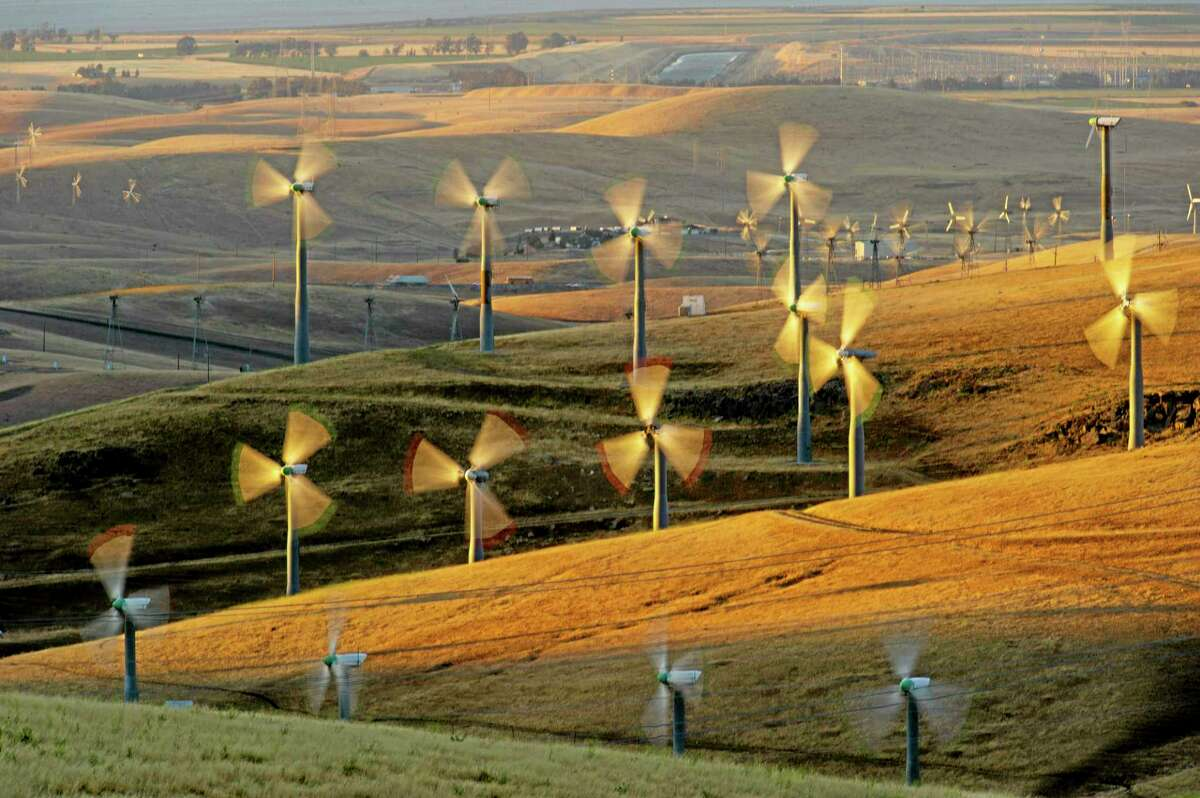 FILE - In this May 12, 2013, photo, wind turbines line the Altamont Pass near Livermore, Calif. A conservation group says itís suing the Obama administration over a new federal rule that allows wind-energy companies to seek approval to kill and injure eagles for 30 years.The lawsuit from the American Bird Conservancy was expected to be filed Thursday, June 19, 2014, in federal court in San Jose, Calif. A copy of the complaint was obtained by The Associated Press on Wednesday. (AP Photo/Noah Berger, File)