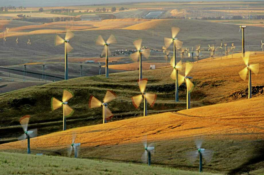 FILE - In this May 12, 2013, photo, wind turbines line the Altamont Pass near Livermore, Calif. A conservation group says itís suing the Obama administration over a new federal rule that allows wind-energy companies to seek approval to kill and injure eagles for 30 years.The lawsuit from the American Bird Conservancy was expected to be filed Thursday, June 19, 2014, in federal court in San Jose, Calif. A copy of the complaint was obtained by The Associated Press on Wednesday. (AP Photo/Noah Berger, File) Photo: AP / FR34727 AP