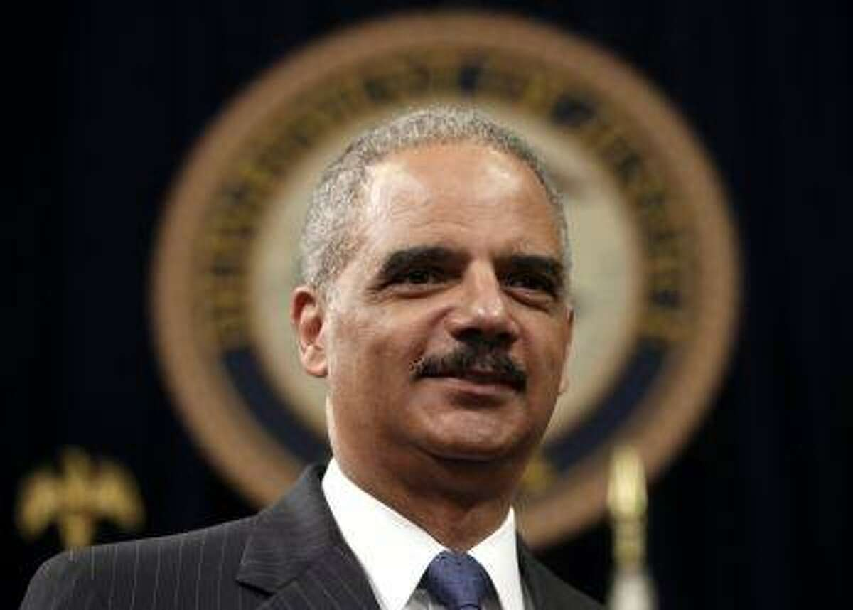 U.S. Attorney General Eric Holder looks on during a special naturalization ceremony at the Department of Justice in Washington May 28, 2013. (Kevin Lamarque/Reuters)