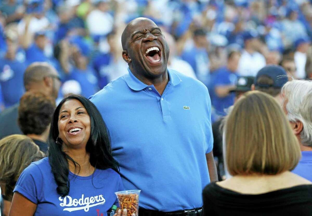 Los Angeles Dodgers owner Magic Johnson, here at Game 3 of the National League division series against the Atlanta Braves, will not return to ESPN as an NBA analyst.