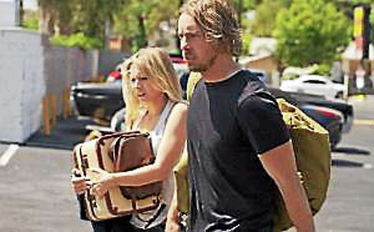 """Kristen Bell and Dax Shepard in a scene from """"Hit and Run."""""""