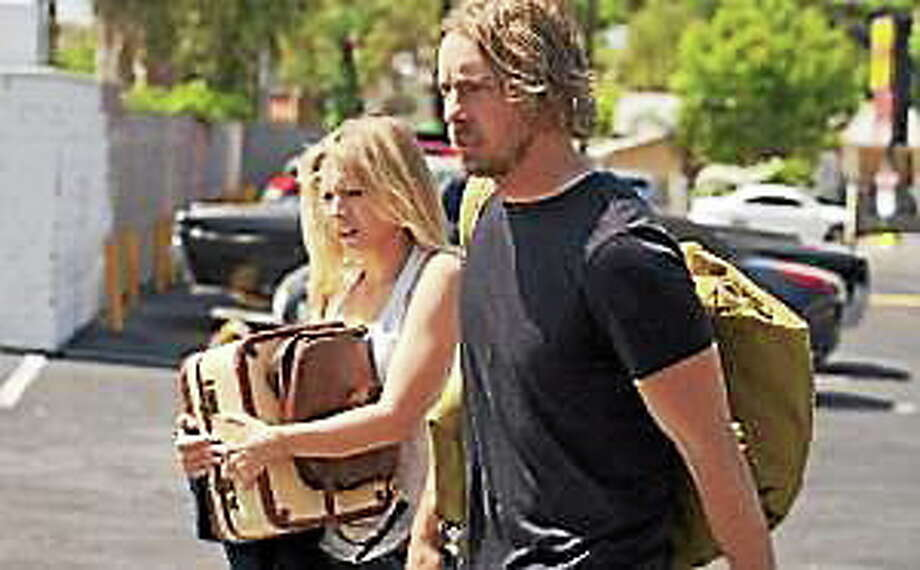 """Kristen Bell and Dax Shepard in a scene from """"Hit and Run."""" Photo: (The Associated Press)"""
