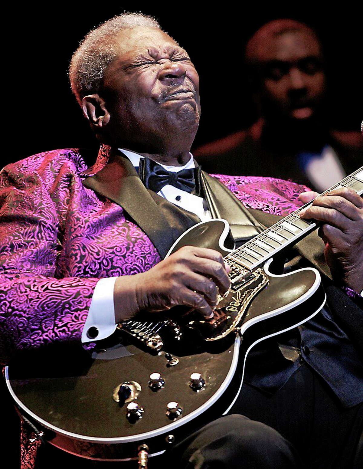 Blues guitarist, singer and songwriter B. B. King, born Riley B. King, is shown performing on stage during a live concert appearance.
