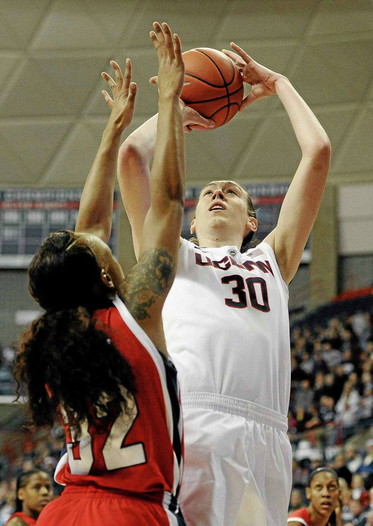 UConn's Breanna Stewart shoots over Houston's Te'onna Campbell, left, in Tuesday's game. Undefeated UConn won 90-40.
