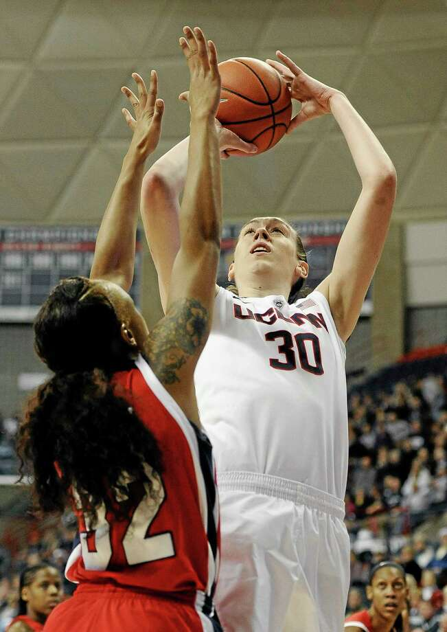 UConn's Breanna Stewart shoots over Houston's Te'onna Campbell, left, in Tuesday's game. Undefeated UConn won 90-40. Photo: Jessica Hill — The Associated Press  / FR125654 AP