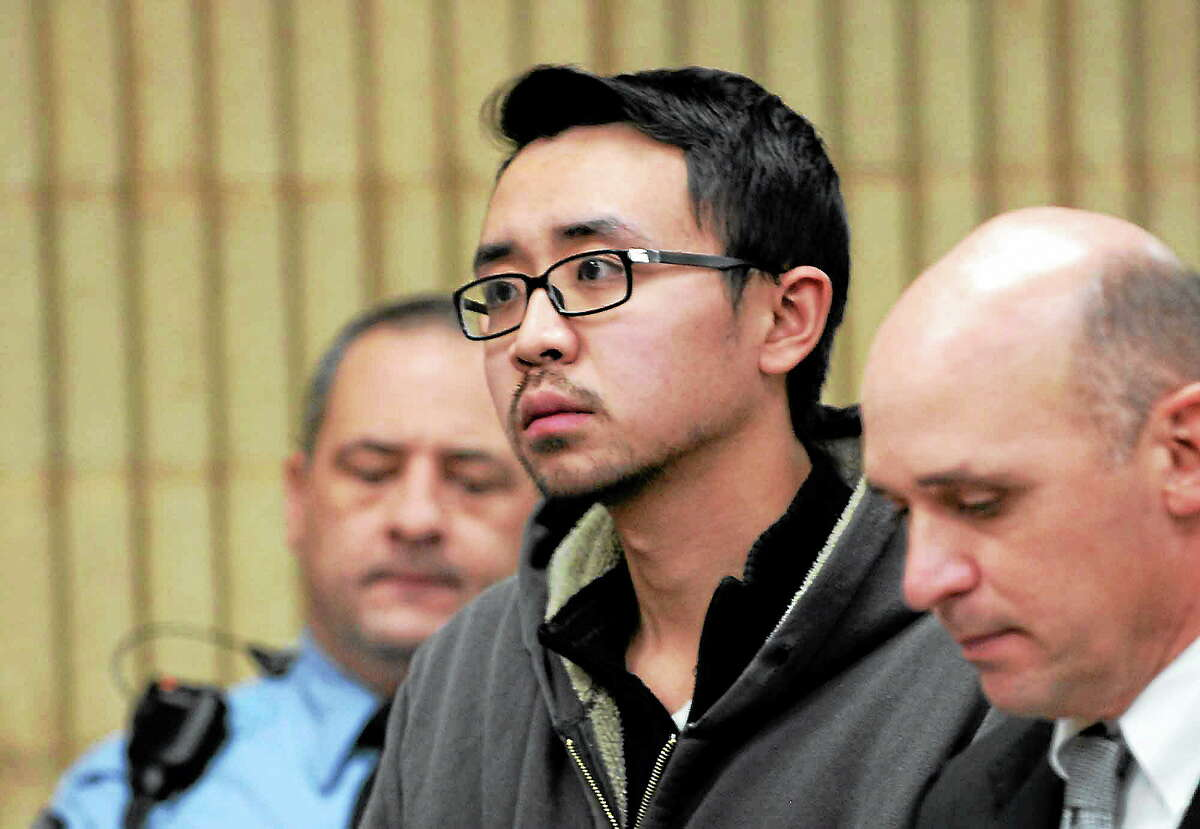 University of New Haven student William Dong, 22, of Fairfield, with assistant public defender Kevin Williams, right, appears during his arraignment Dec. 4, 2013, at Superior Court in Milford, Conn. Dong was charged with illegal possession of an assault weapon and other crimes after a scare the day before, which led to a UNH campus lockdown of more than four hours. Police say they don't know why Dong brought guns to the campus. (AP Photo/The Connecticut Post, Autumn Driscoll, Pool)