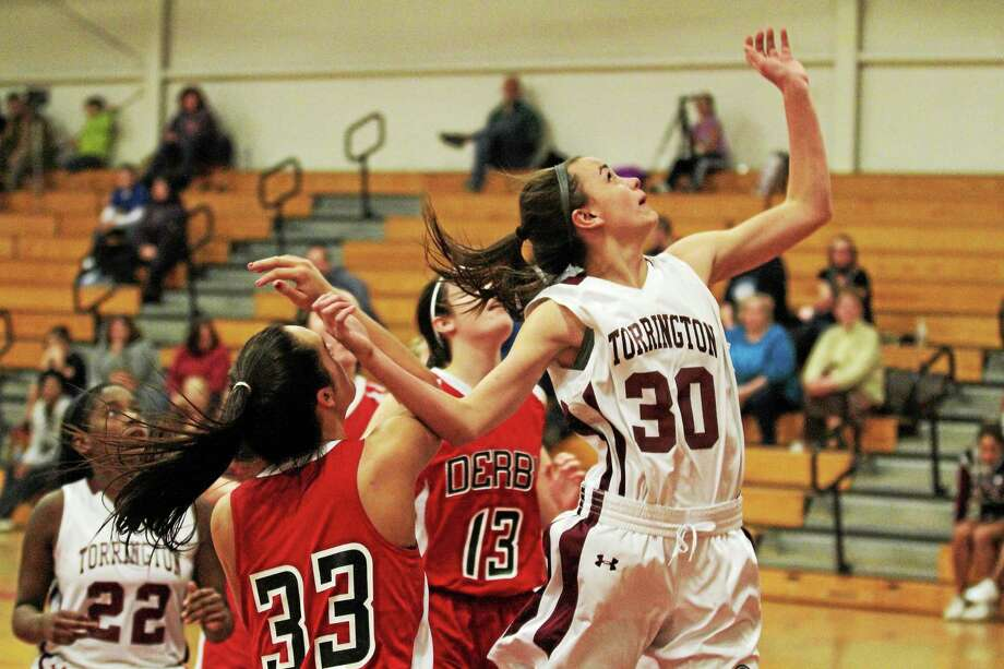 Torrington's Olivia Morrison puts up a layup during the Red Raiders 71-41 win over Derby. Morrison finished with nine points in the win. Photo: Marianne Killackey — Special To The Register Citizen  / 2013