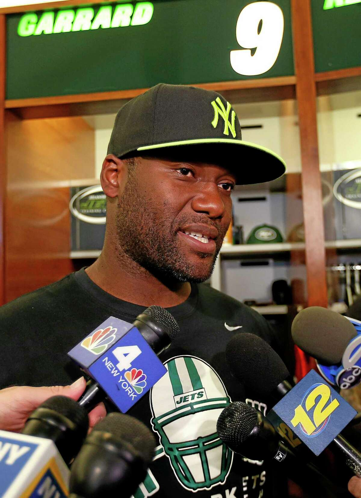 In this May 2 file photo, New York Jets quarterback David Garrard talks to reporters during a locker room availability at the team's practice facility in Florham Park, N.J. After considering retirement the last few months, Garrard has re-signed with the Jets to serve as a veteran backup and mentor to rookie Geno Smith, the team announced Thursday.