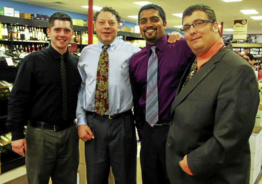 The managing staff at Bottle Stop, from left: Vincent DiMeglio, Darius Kadagian, Hitesh Patel and Philippe Rummens as seen Friday in Torrington. Photo: Esteban L. Hernandez — The Register Citizen