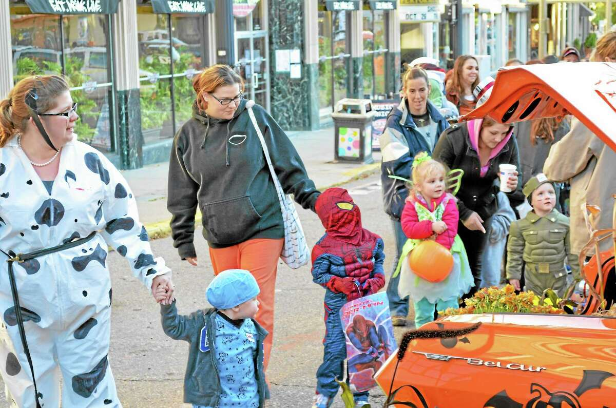 Cars lined Torrington's Main Street in October 2013 with trunks full of candy for passing children to get some trick or treating in early.