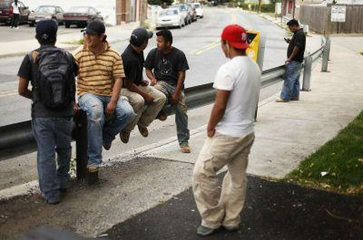 A group of immigrant day laborers stand near a street corner waiting for work in the Staten Island borough of New York on Aug. 3, 2010. Reuters/Lucas Jackson