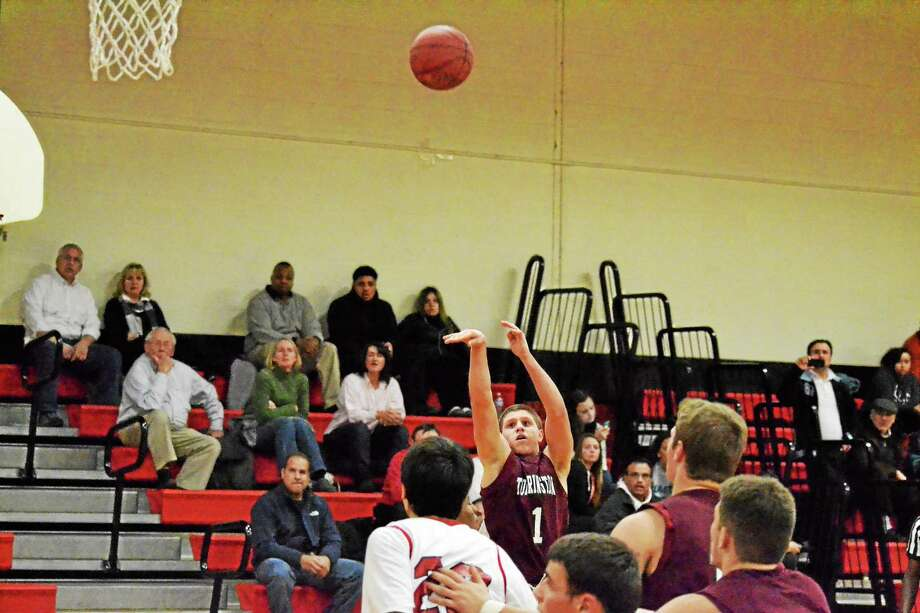 Torrington's Zak Mancini takes a three-pointer in the Red Raiders 79-54 win over Derby. Mancini scored 20 points in the win. Photo: Pete Paguaga — Register Citizen