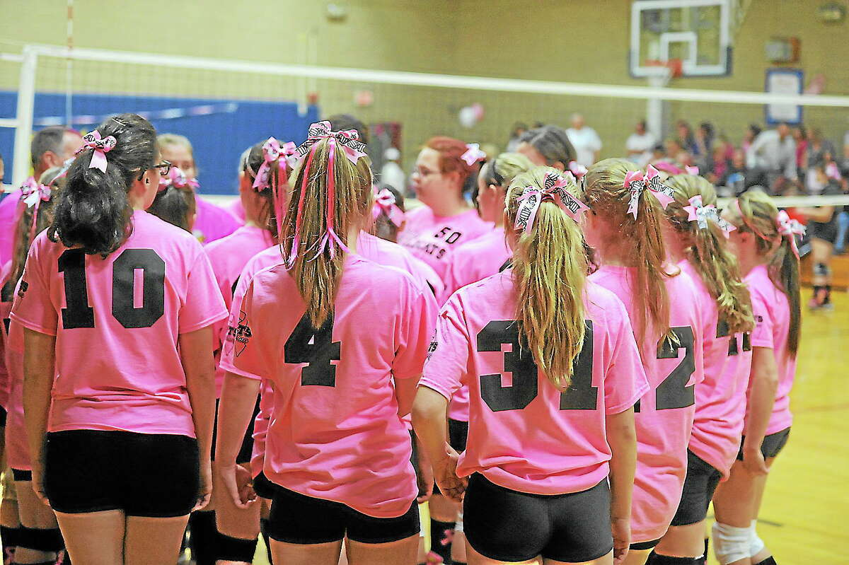 Wolcott Tech, in pink jerseys, huddles up during its 3-1 victory over Gilbert.