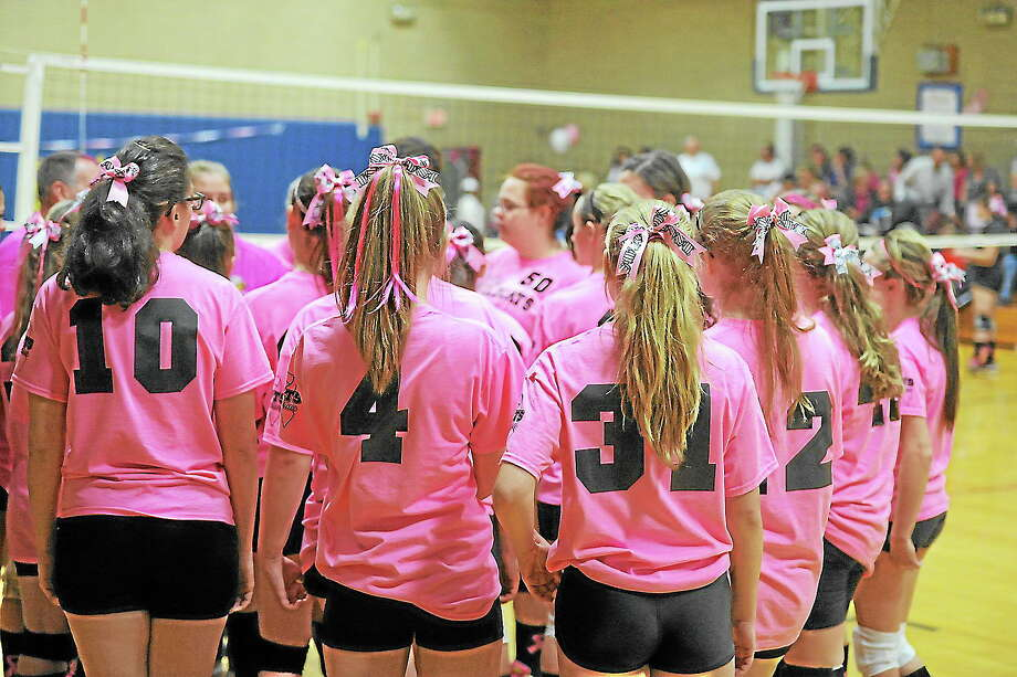 Wolcott Tech, in pink jerseys, huddles up during its 3-1 victory over Gilbert. Photo: Laurie Gaboardi — Register Citizen