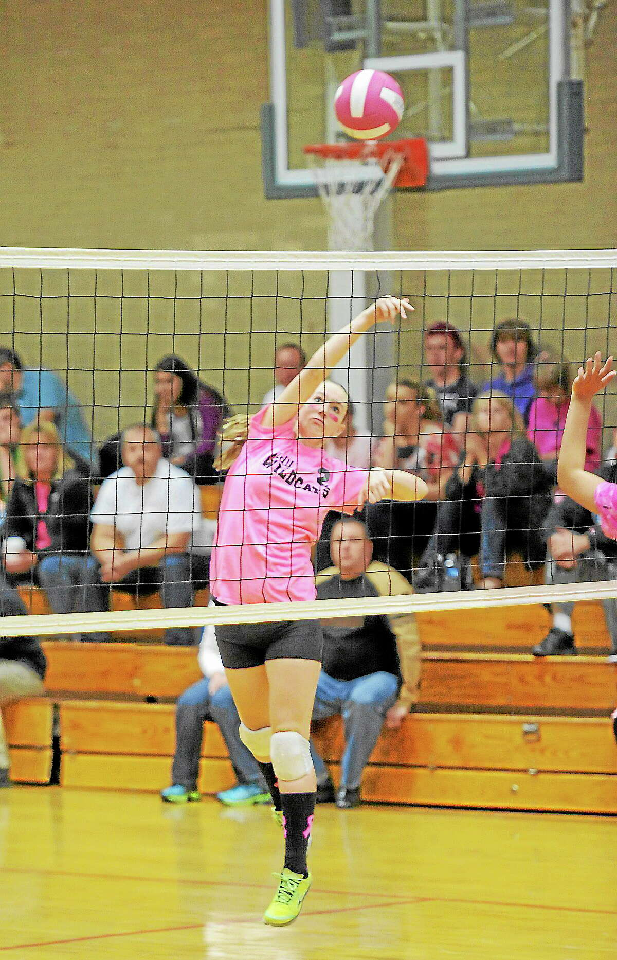 Wolcott Tech's Emily Andrews spikes one of her six kills in the Wildcats 3-1 win over Gilbert.