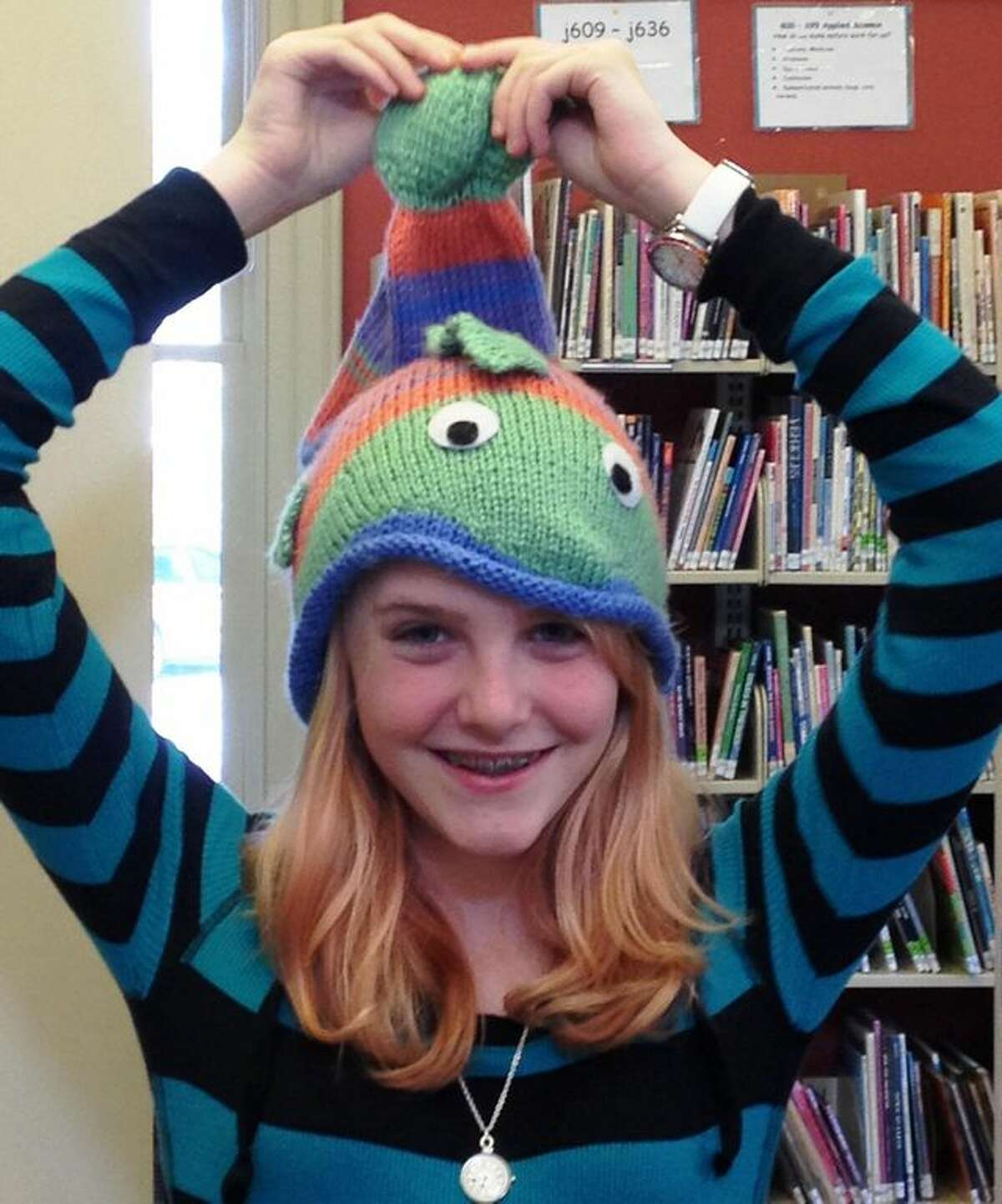 Twelve-year-old Eliana Giantonio and her fish hat that was the spark for her fish hat drive for the Connecticut Children's Medical Center Hematology/Oncology department.