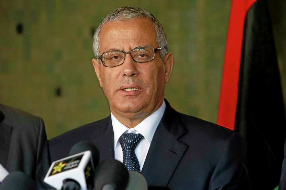 In this Tuesday, Oct. 8, 2013 file photo, Libyan's Prime Minister Ali Zidan speaks to the media during a press conference in Rabat, Morocco. Zidan was snatched by gunmen before dawn Thursday from a Tripoli hotel where he resides, the government said. The abduction appeared to be in retaliation for the U.S. special forces' raid over the weekend that seized a Libyan al-Qaida suspect from the streets of the capital. (AP Photo/Abdeljalil Bounhar) Photo: AP / AP
