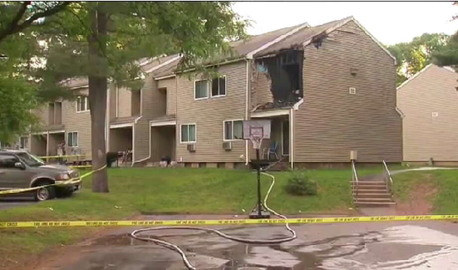 A young girl was killed in a fire that damaged a Southington apartment building on Sunday. Photo from WTNH-TV. Photo: Journal Register Co.
