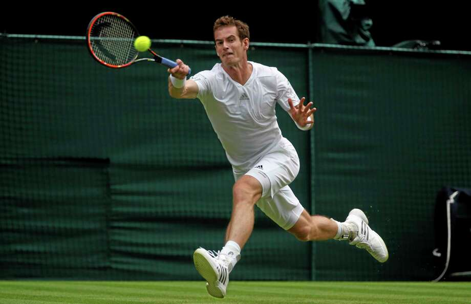 Andy Murray of Britain plays a return to David Goffin of Belgium during their first round match at the All England Lawn Tennis Championships in Wimbledon, London,  Monday, June  23, 2014. (AP Photo/Pavel Golovkin) Photo: AP / AP