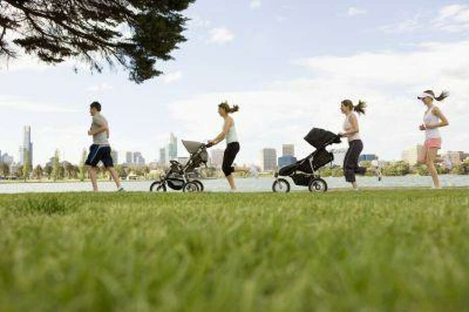 Cities that provide parks, walking trails, playing fields and running tracks are setting standards for the country's healthiest urban areas and showing that if they build fitness opportunities, residents will come. (FUSE) Photo: Getty Images/Fuse / Fuse
