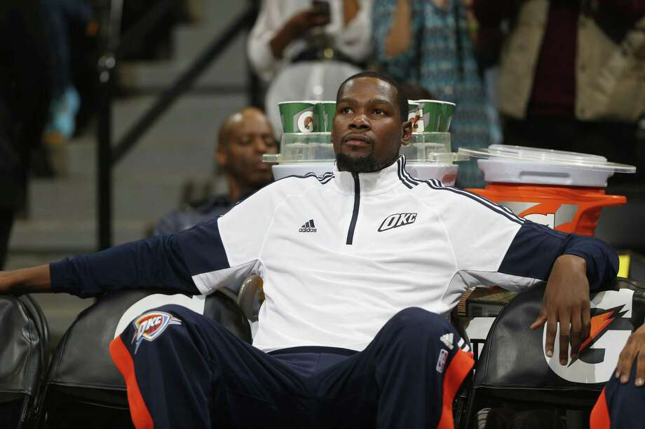 Oklahoma City Thunder forward Kevin Durant will likely miss the first six to eight weeks of the season after fracturing a bone in his right foot. Photo: David Zalubowski — The Associated Press  / AP