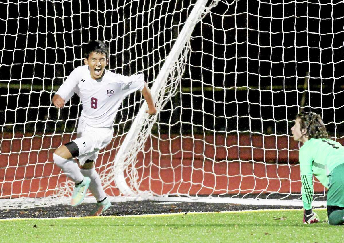 Torrington's Kevin Vaca celebrates his second goal in the Red Raiders' 5-2 win over Seymour Thursday night.