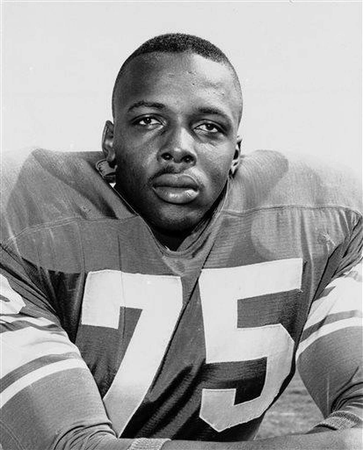 """FILE - This 1963 file photo shows David Deacon Jones. Jones, a Hall of Fame American football defensive end credited with terming the word sack for how he knocked down quarterbacks, has died. He was 74. The Washington Redskins said that Jones died Monday night June 3, 2013 of natural causes at his home in Southern California. Redskins general manager Bruce Allen, whose father, George, coached Jones with the Los Angeles Rams, calls Jones """"one of the greatest players in NFL history. (AP Photo/File)"""