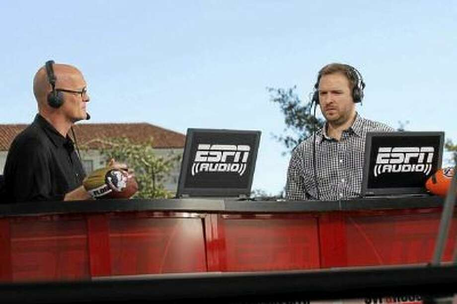 Scott Van Pelt, left, and Ryen Russillo, of SVP & Russillo, ESPN sport talk radio show hosts, broadcast live before the BCS National Championship Game, in front of the Pasadena City Hall in Pasadena, CA., Monday.