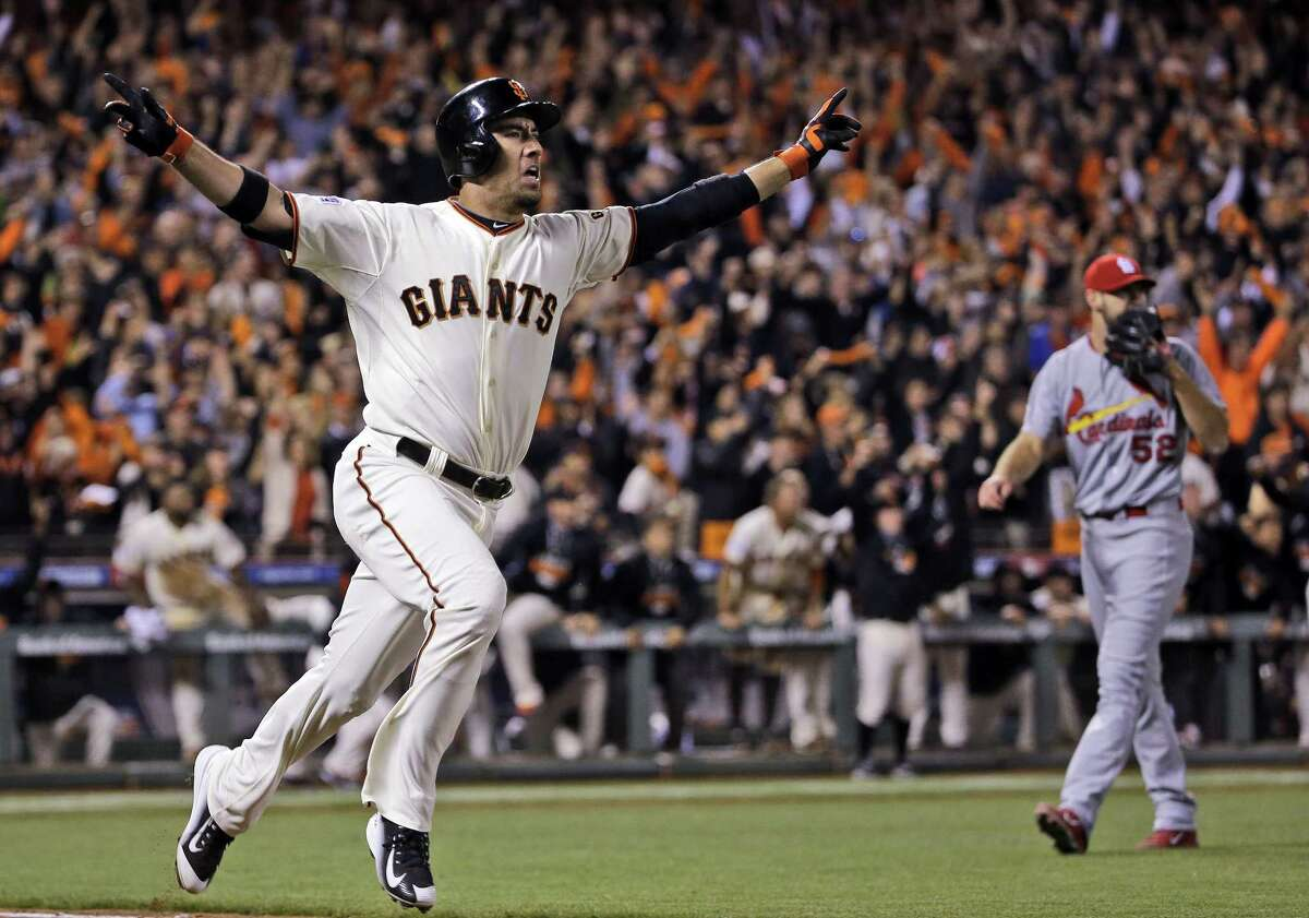 The Giants' Travis Ishikawa reacts after hitting a walk-off three-run home run during Game 5 of the NLCS against the Cardinals on Thursday.
