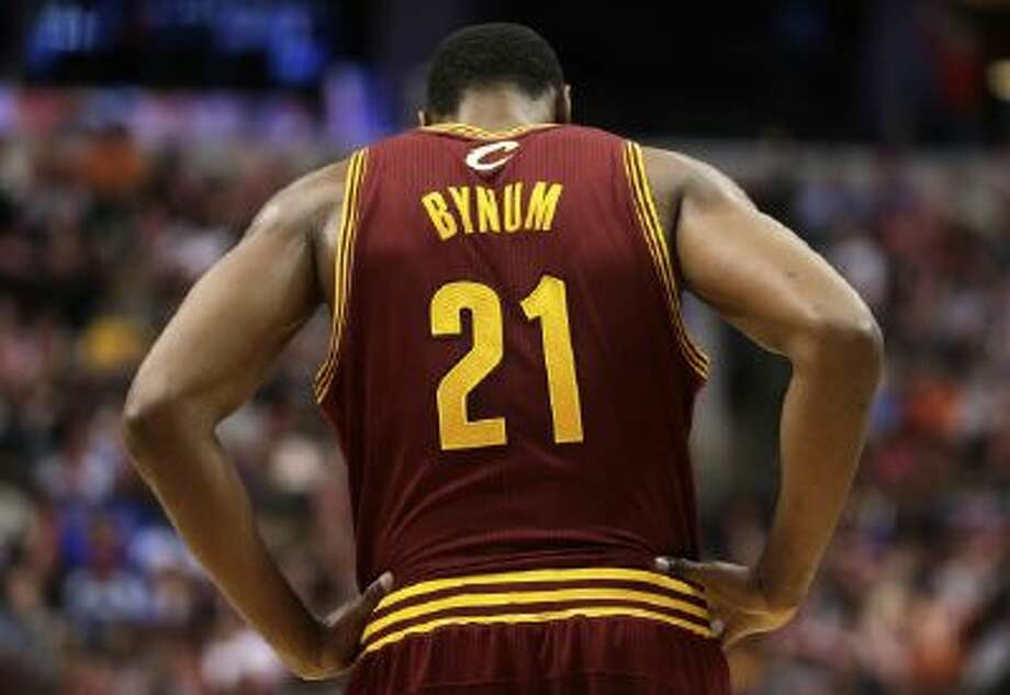 In this Nov. 8, 2013, file photo, Cleveland Cavaliers' Andrew Bynum pauses during an NBA basketball game against the Philadelphia 76ers in Philadelphia.