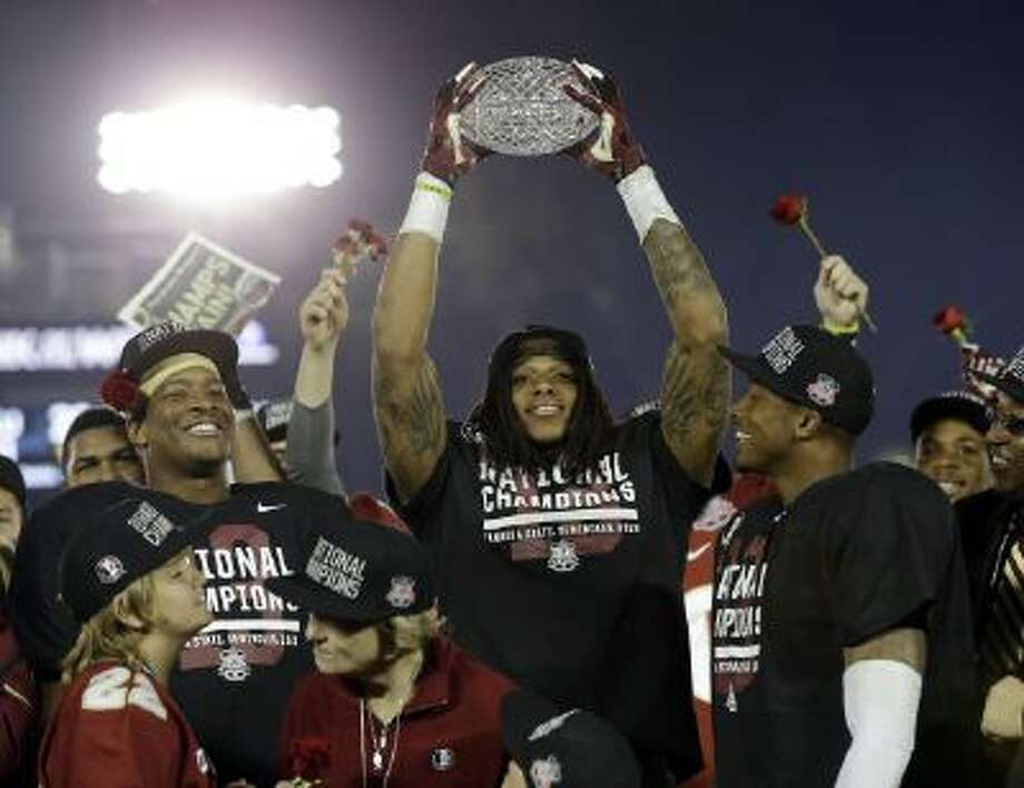Florida State's P.J. Williams celebrates Florida State's championship win.