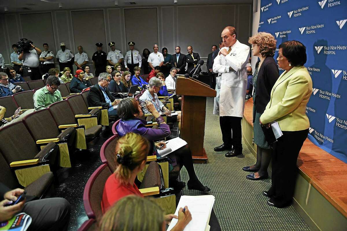 Dr. Thomas Balcezak, Chief Medical Officer for Yale-New Haven Hospital, answers questions during a press conference at the Yale School of Medicine concerning a patient who had visited Liberia showing a possible symptom of the Ebola virus on 10/16/2014. agold@newhavenregister.com Photo by Arnold Gold/New Haven Register
