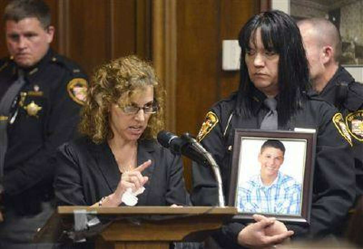 Dina Parmertor, mother of victim Daniel, speaks during the sentencing of T.J. Lane Tuesday, March 19, 2013, in Chardon, Ohio. Lane, was given three lifetime prison sentences without the possibility of parole Tuesday for opening fire last year in a high school cafeteria in a rampage that left three students dead and three others wounded.