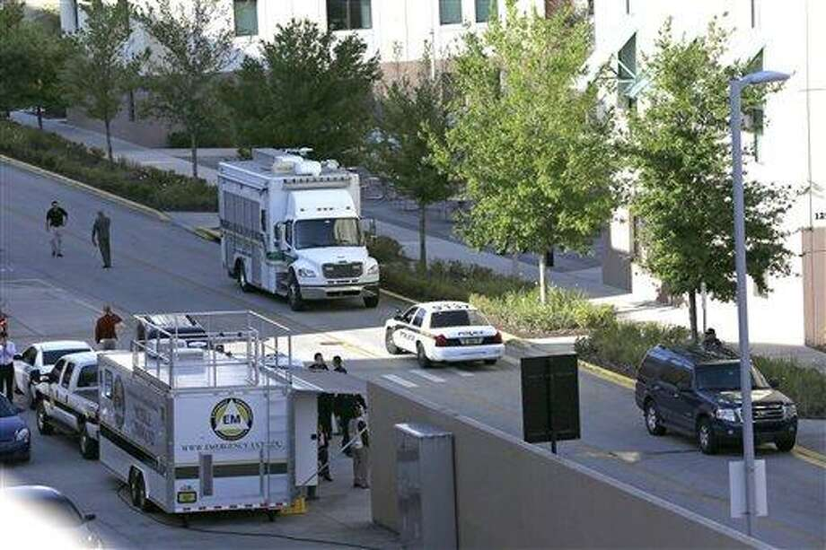Various police agencies are seen during an investigation at the University of Central Florida, Monday, March 18, 2013, in Orlando, Fla., after explosive devices were found by authorities investigating the apparent suicide of a college student in the dorm. Hundreds of students were evacuated, though the school said there was no immediate threat.   (AP Photo/John Raoux) Photo: ASSOCIATED PRESS / AP2013