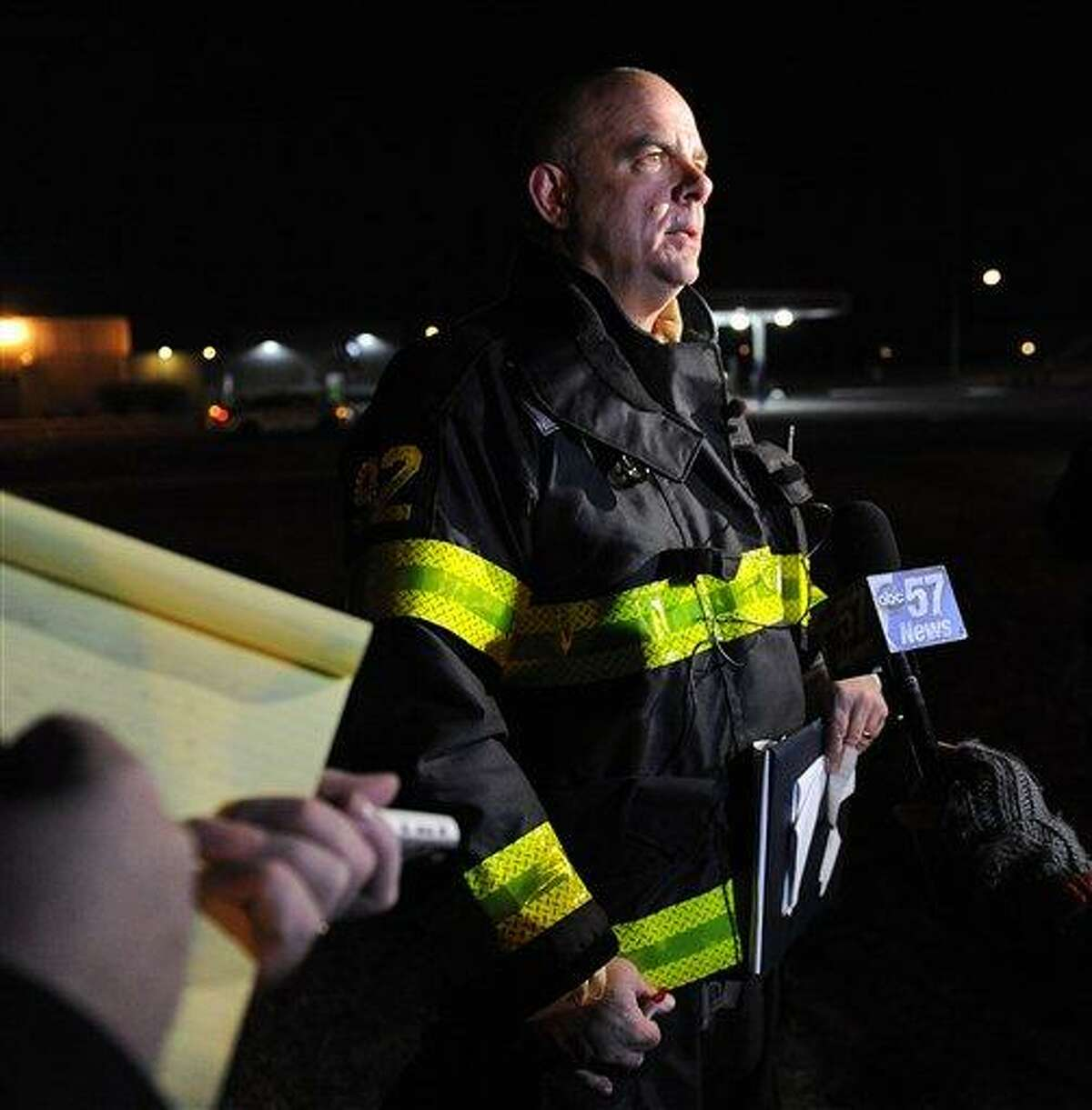 South Bend Fire Department Assistant Chief John Corthier answers questions about a plane crash that occurred near the South Bend Regional Airport Sunday March 17, 2013 in South Bend, Ind. The private jet apparently experiencing mechanical trouble crashed in a northern Indiana neighborhood, resulting in injuries and striking three homes, authorities and witnesses said. (AP Photo/Joe Raymond)