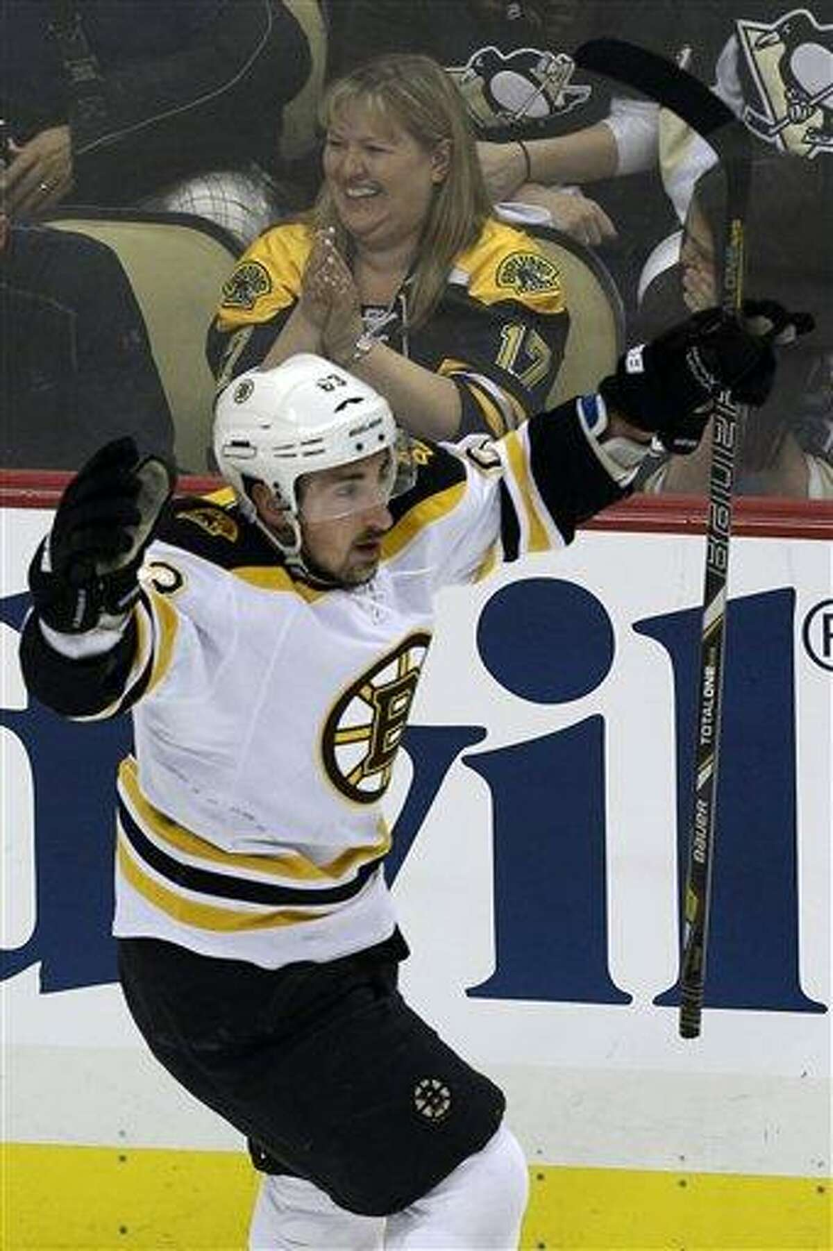Boston Bruins' Brad Marchand (63)celebrates scoring in the first period of Game 2 of the NHL hockey Stanley Cup Eastern Conference finals against the Pittsburgh Penguins in Pittsburgh Monday, June 3, 2013.(AP Photo/Gene J. Puskar)