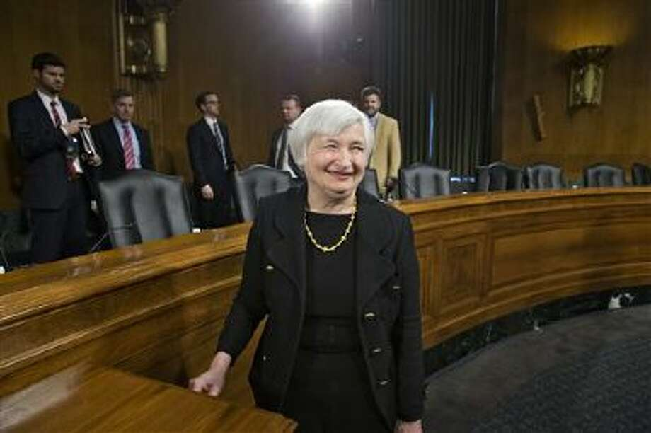 Janet Yellen, President Obama's nominee to succeed Ben Bernanke as Federal Reserve chairman, smiles as she finishes testifying at her confirmation hearing before the Senate Banking Committee on Capitol Hill in Washington. A Senate panel on Thursday advanced Yellen's nomination to lead the Federal Reserve, setting up a final vote in the full Senate after lawmakers return from a two-week Thanksgiving break. Photo: AP / AP