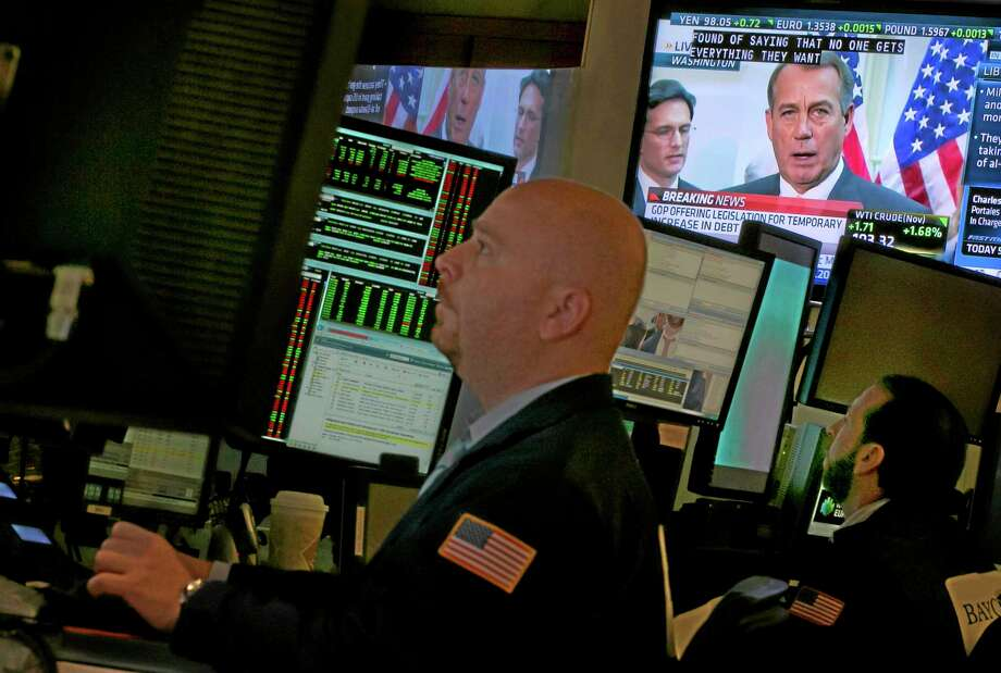 House Speaker John Boehner is visible on a television screen from Washington, on the floor of the New York Stock Exchange, Thursday, Oct. 10, 2013.  Boehner told Republican lawmakers Thursday he will give President Barack Obama a proposal extending the government's ability to borrow money through Nov. 22, but only if he agrees to negotiate over ending the partial government shutdown and a longer-term increase in the debt ceiling. (AP Photo/Richard Drew) Photo: AP / AP